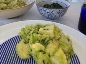 Artichoke hearts and broad beans with coriander and lemon.
