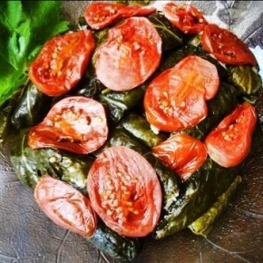 Vine leaves with herbed rice by Cecile Yazbek.