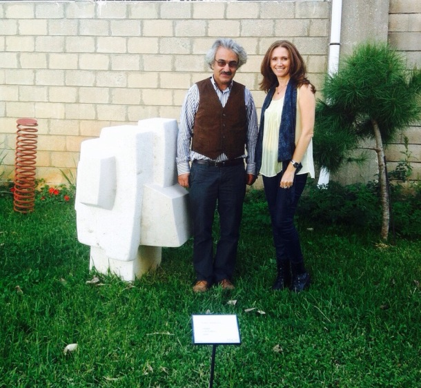 Nabil Basbous, the son of Youssef Basbous, featured sculptor in current exhibition Age of Wood, and myself next to one of his sculptures.