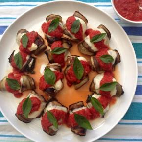 Eggplant, spinach and Bocconcini rolls with tomato sauce and basil.