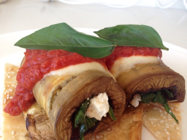 Eggplant, spinach and bocconcini roll, with tomato sauce and basil