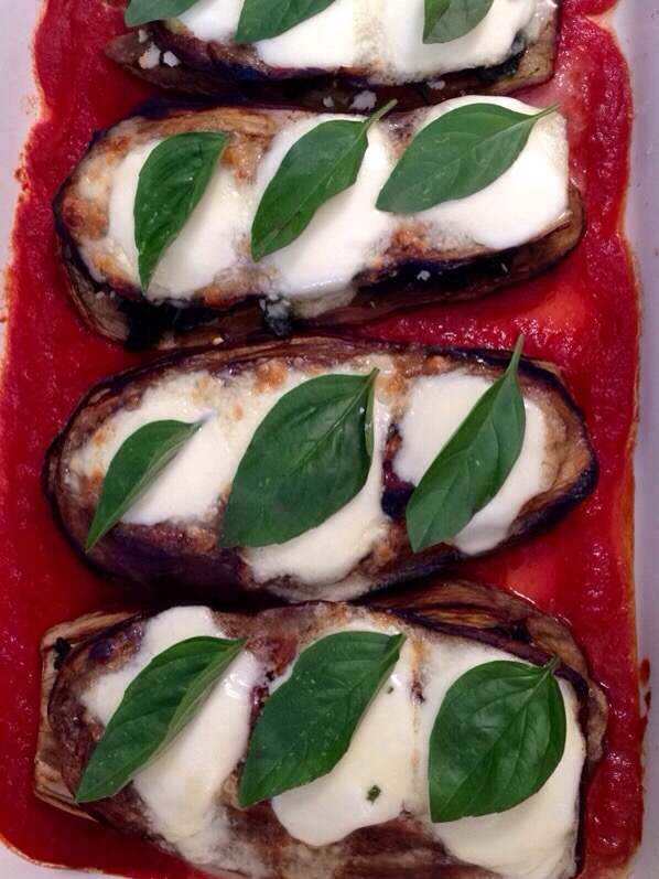 Eggplant with fetta, spinach and bocconcini, with tomato sauce and basil