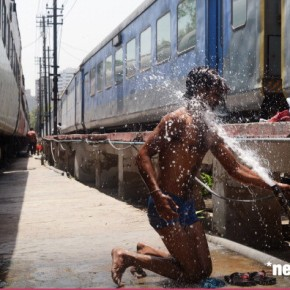 Man Washing on a Railway Platform outside Delhi